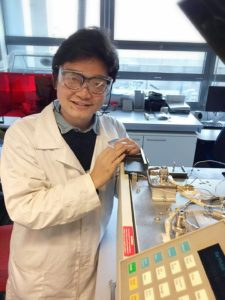 Huian_Liu_in_lab_with_GC_instrument
