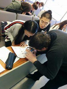 Dr_Thompson_examining_fingerprints_with_students