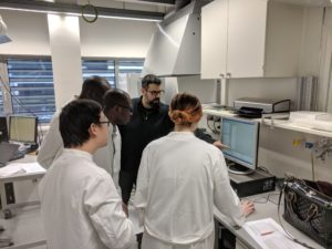 Todd_Pagano_working_with_EACH_students_in_lab